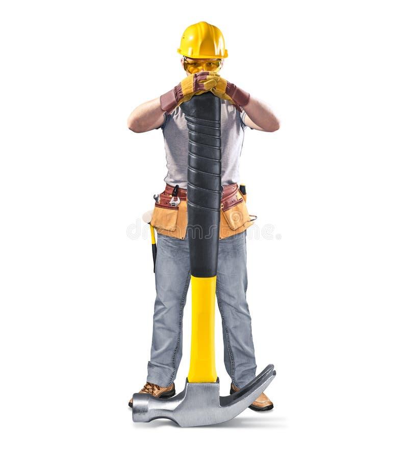 Pracownik budowlany w hełmie z narzędziem i młotem obraz stock