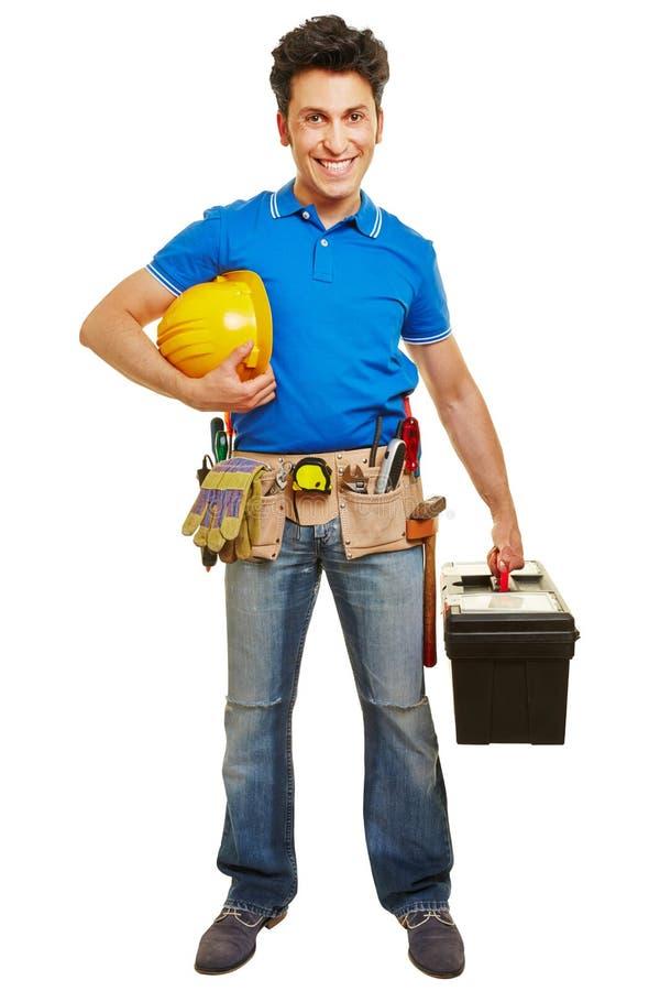 Pracownik z hardhat i toolbox zdjęcie stock