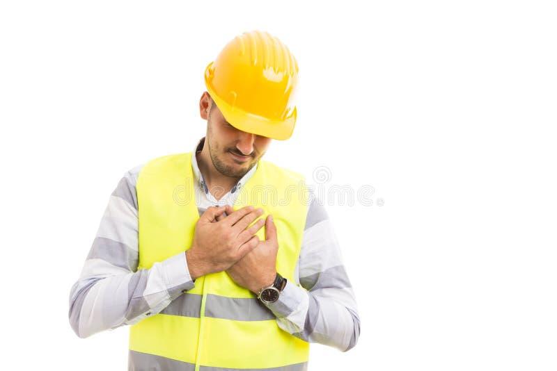 Pracownika budowlanego budowniczego lub inżyniera cierpienia serca ból zdjęcia royalty free