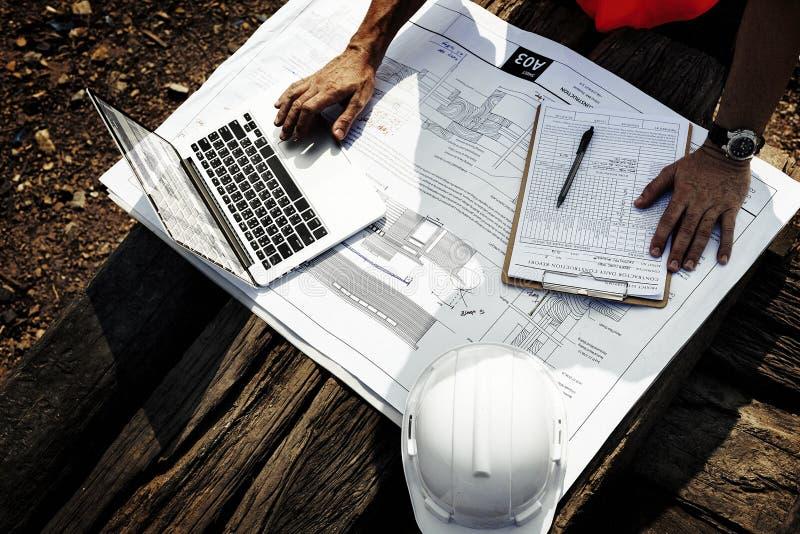 Pracownika Budowlanego kontrahenta przedsiębiorcy budowlanego Planistyczny pojęcie fotografia royalty free
