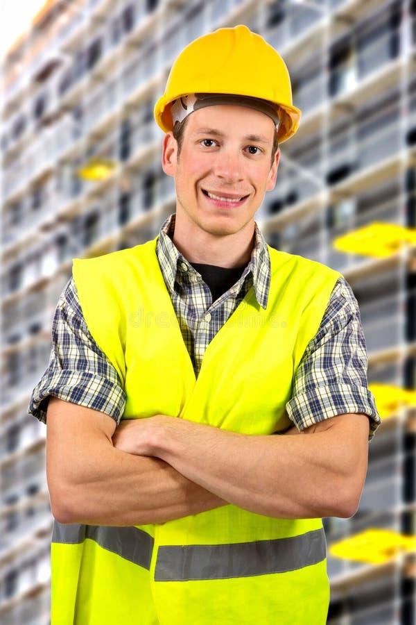 Pracownika budowlanego ono uśmiecha się zdjęcia royalty free