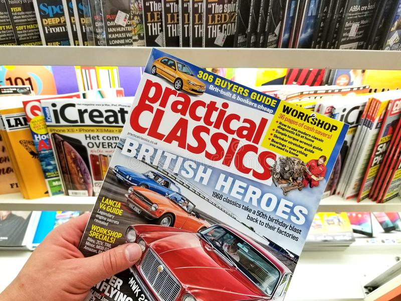 Practical Classics magazine in a hand royalty free stock photos