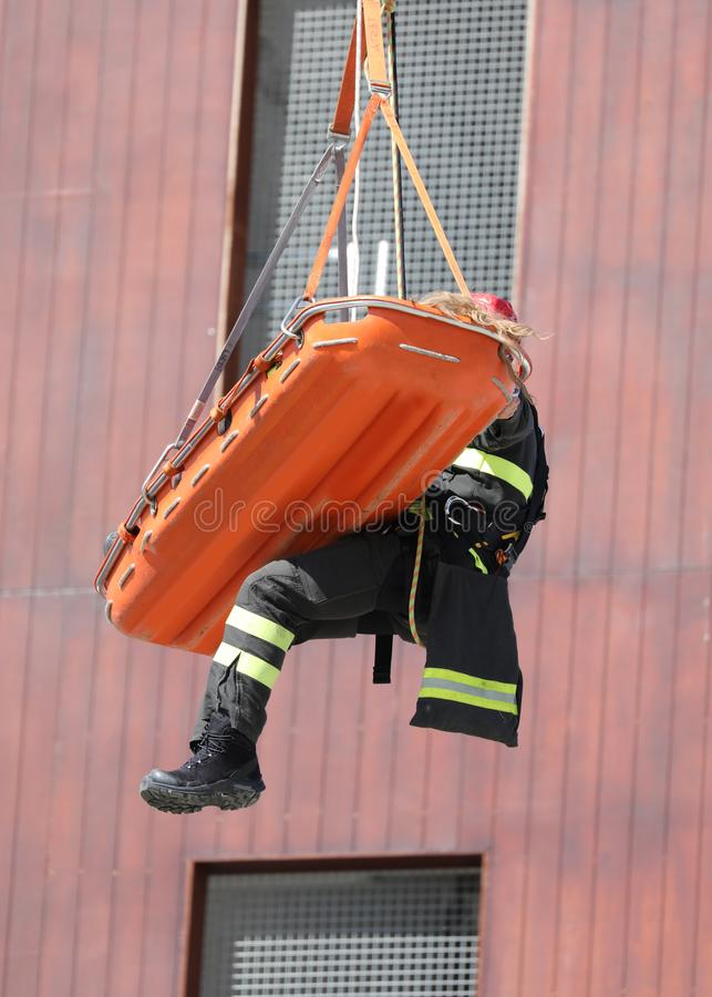 Practice on the fire department with firefighter. And the stretcher royalty free stock image