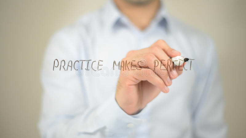 Practice Makes Perfect , man writing on transparent screen stock image
