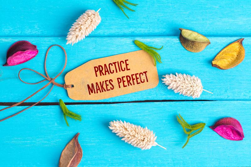 Practice makes perfect text on paper tag royalty free stock photos