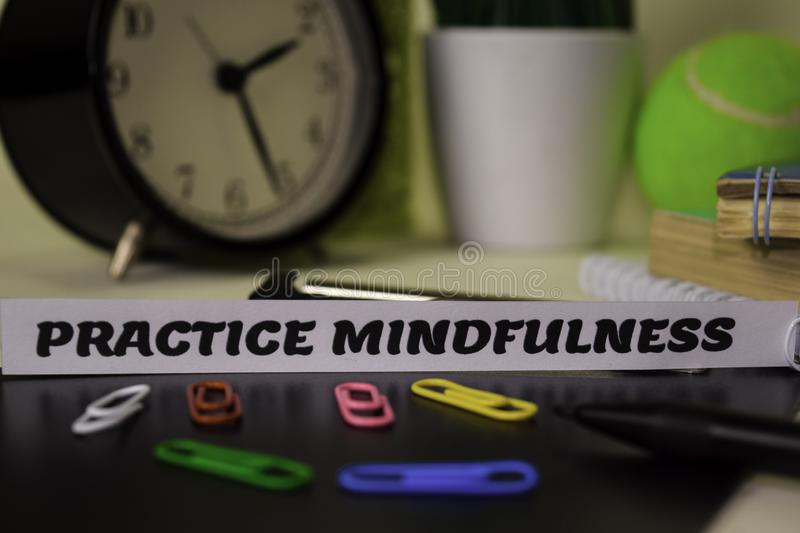 Practice Mindfulness on the paper isolated on it desk. Business and inspiration concept stock photography