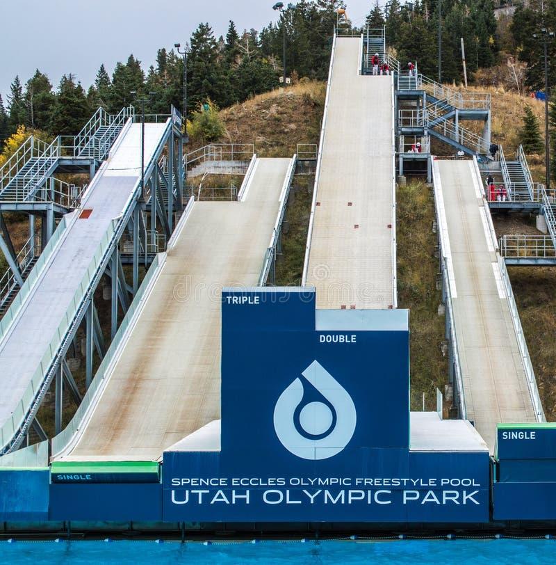 Practice ski ramps at Utah Olympic Park. Four practice ski ramps for freestyle skiers landing in a swimming pool at Utah Olympic Park in Park City, Utah royalty free stock images