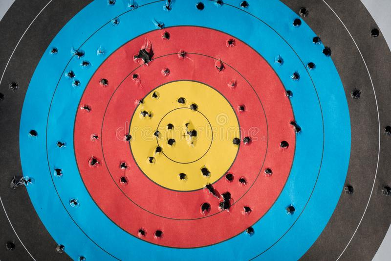 Practice target used for shooting with bullet holes in it. royalty free stock photos
