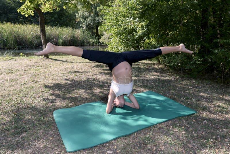 Practice Yoga Pregnancy Pose Split. Selective focus stock photos