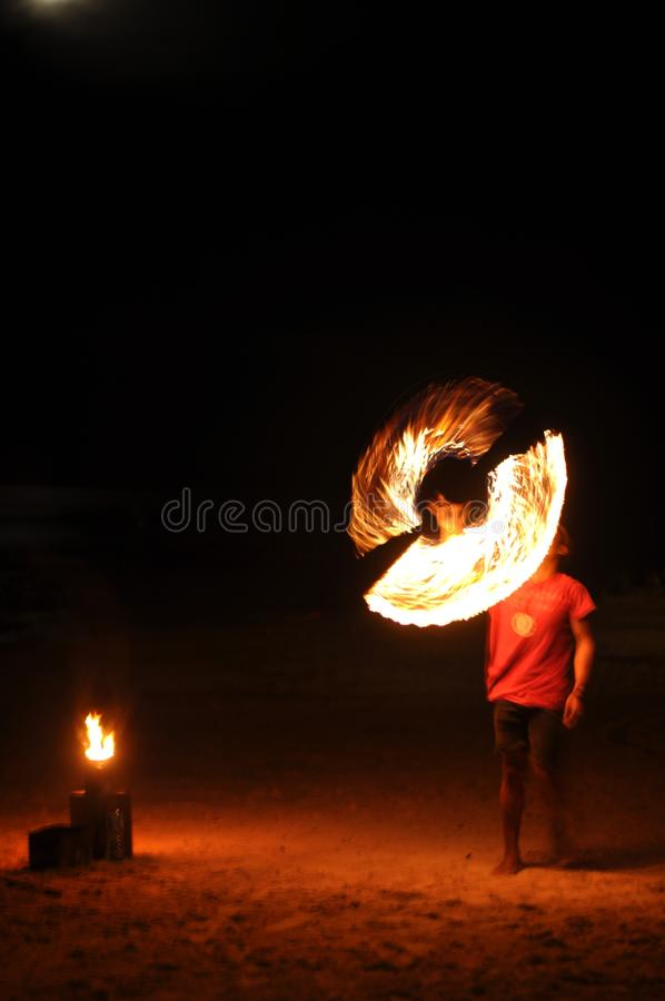 Practicing flame juggler stock photography