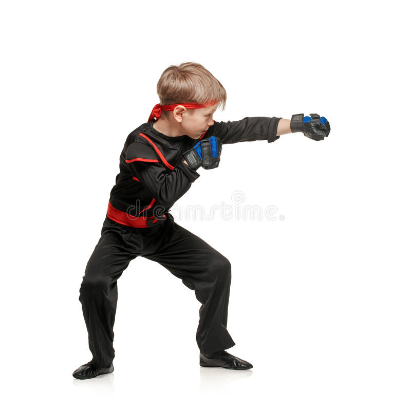 Practicing little boy martial arts royalty free stock photo