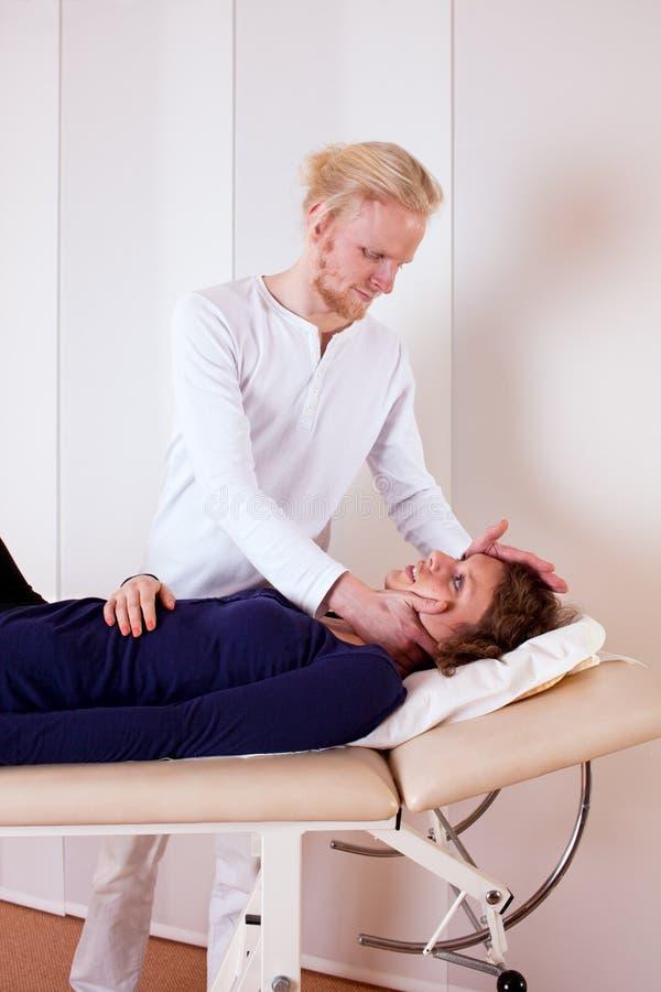 Practitioner Manipulating Patient's Neck stock image