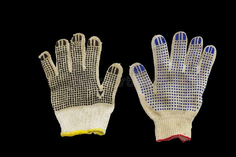 Pracujące rękawiczki z barwionymi gumowymi kropkami, czarny tło obrazy stock