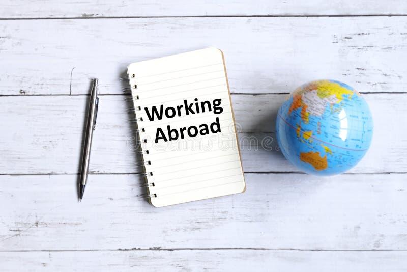 Pracujący Za granicą obraz stock