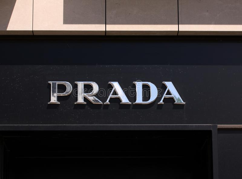 Prada logo on front store in shopping street. Prada is a world famous fashion brand founded in Italy. stock photography