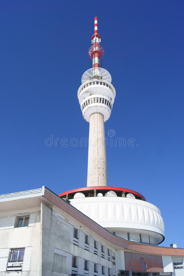 Praded outlook tower. And TV and GSM transmitter at nice sunny day stock image