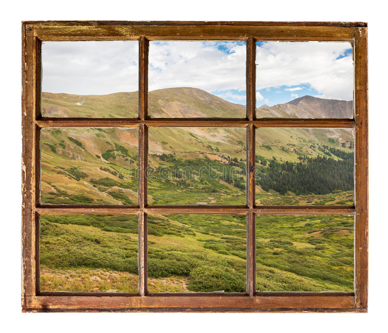 Prados alpinos en Rocky Mountains - opinión de la ventana foto de archivo