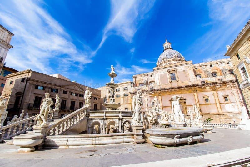Praetoria Fountain in Palermo, Italy. The Praetoria Fountain with the dome of Santa Caterina in the background, in the square of Shame, Palermo, Italy royalty free stock image