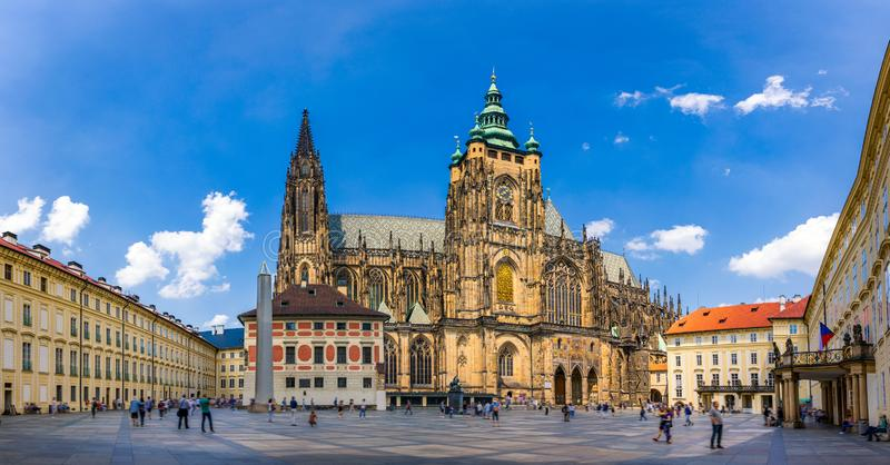 Prague, bell gothic towers and St. Vitus Cathedral. St. Vitus is a Roman Catholic cathedral in Prague, Czech Republic. Panoramic. View from the courtyard to the stock photography