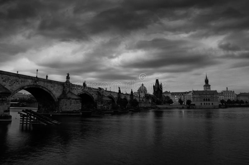 Prague, black and white art photo. Charles Bridge are the symbols of Czech capital, built in medieval times. Misty morning with. Storm clouds. Travelling in the stock images