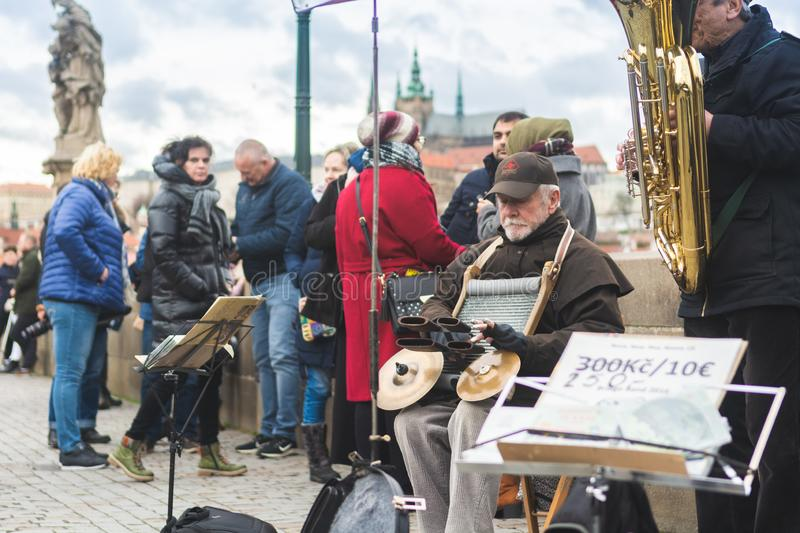 Prague, Bohemia, Czech Republic - December 2018: music band on Charles bridge stock photography