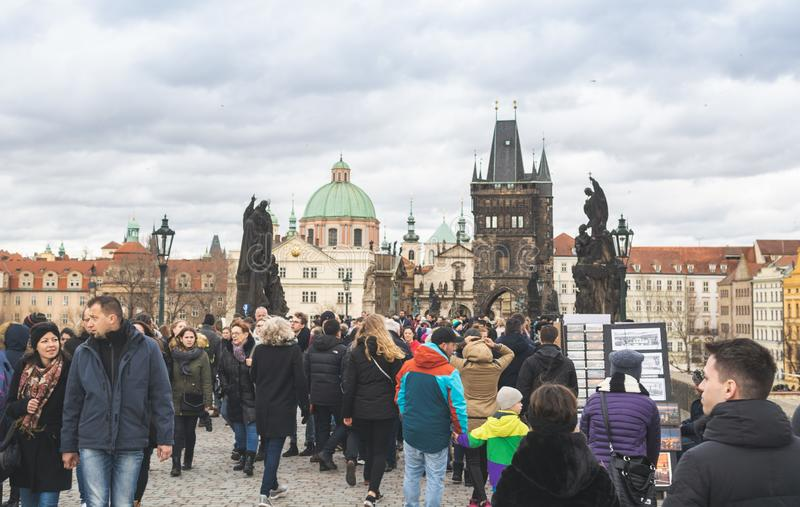 Prague, Bohemia Czech Republic - December 2018: Tourists on the Charles bridge royalty free stock photography