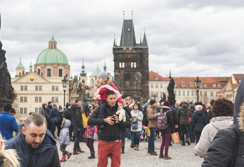 Prague, Bohemia Czech Republic - December 2018: Tourists on the Charles bridge stock images