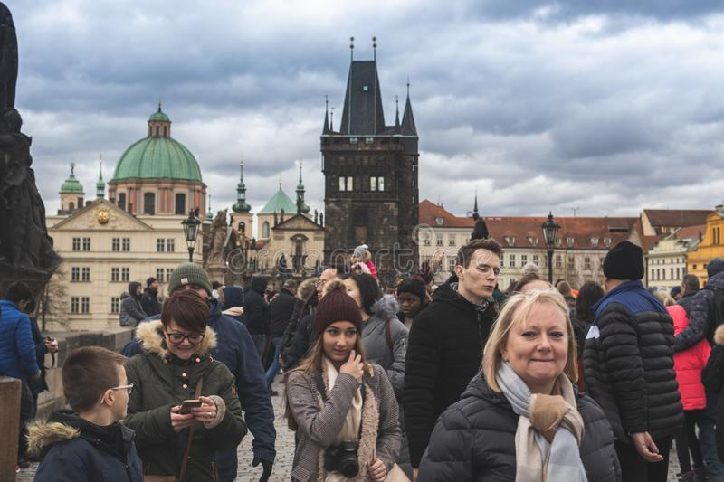 Prague, Bohemia Czech Republic - December 2018: Tourists on the Charles bridge stock image