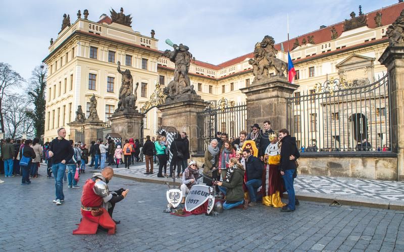 Prague, Bohemia / Czech Republic - November 2017: Tourists making a group photo with animators dressed in armour. In front of Giants` Gate Wrestling Giants and royalty free stock photo