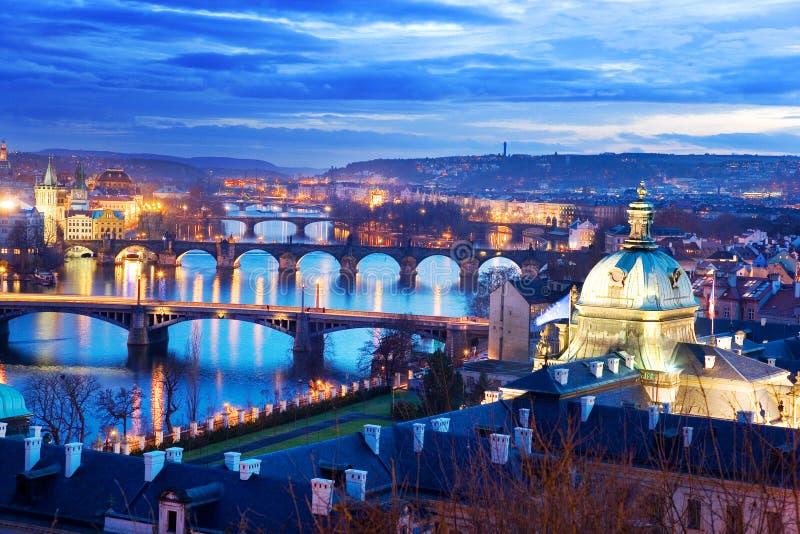 Prague bridges and Moldau river from Letna orchards, Lesser Town, Prague, Czech republic. Night view stock images