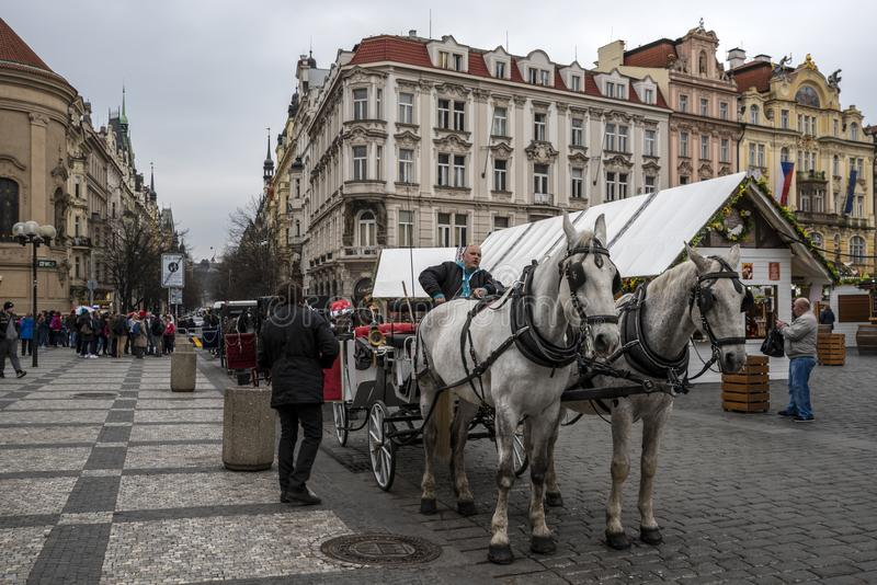 "Horses carriage in Prague. Prague, capital city of the Czech Republic, is bisected by the Vltava River. Nicknamed ""the City of a Hundred Spires,"" royalty free stock image"