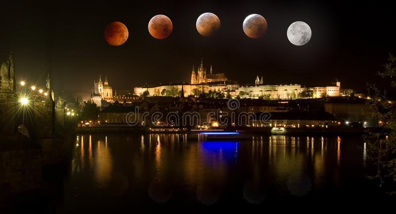 Prague Castle in Czech Republic with total eclipse of moon. The Prague Castle in Czech Republic with total eclipse of moon stock photos
