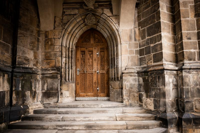 Prague Castle - Gothic architecture of st. Vitus cathedral back door. Czech Republic. Travel photography stock images