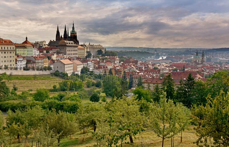 Prague Castle panorama stock images. Sunrise over Prague stock images. Ancient architecture in Prague. Prague old town. View of the Hradcany. Parks and open stock images