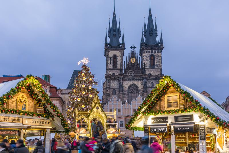 Prague Christmas market on the night in Old Town Square with blu stock photography