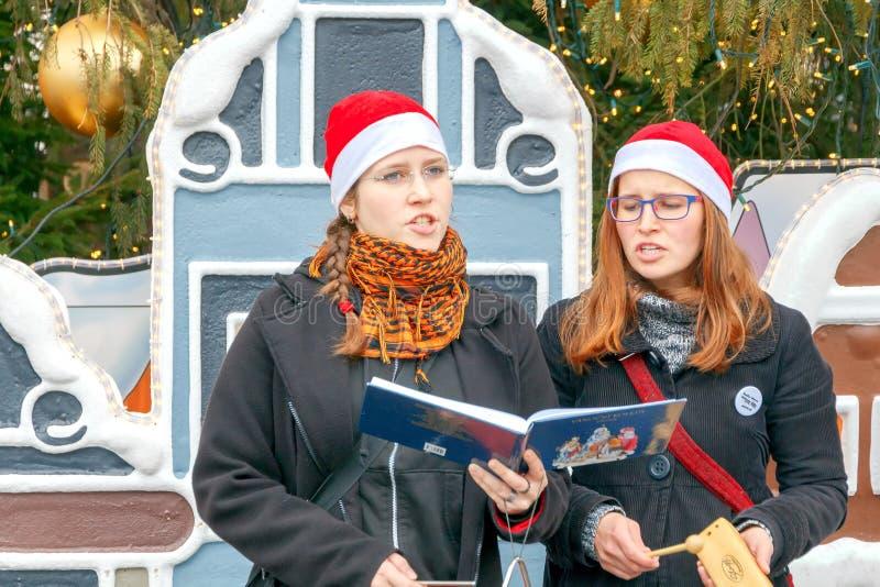 Choir Singing Christmas Carols. Editorial Stock Image - Image of singing, green: 22584374