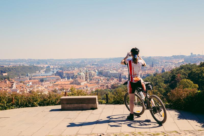 Prague city panorama view and cyclist in Czech royalty free stock image