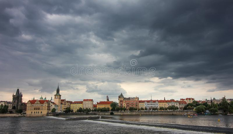 Prague city view, dramatic cloudy weather. Prague city view, dramatic cloudy, rainy weather, Vltava River, beautiful buildings, beautiful dramatic light stock photography