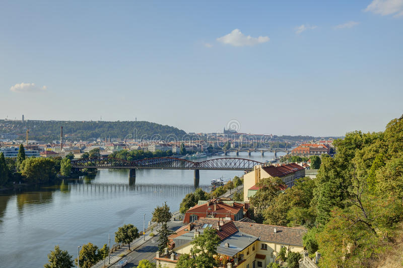 Prague cityscape in late afternoon sun with the Vltava river flowing through the heart of the city, Czech republic. Photo taken at Vysehrad stock images
