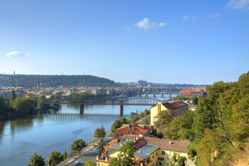 Prague cityscape in late afternoon sun with the Vltava river flowing through the heart of the city, Czech republic. Photo taken at Vysehrad royalty free stock image