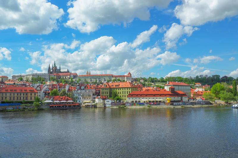 Prague cityscape with a view of Prague Castle and St Vitus Cathedral from Charles Bridge on a sunny day. stock photo