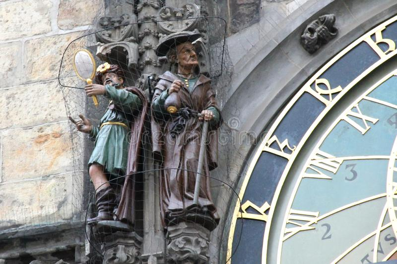 Figures of Vanity and Avarice on the Prague Astronomical Clock stock image