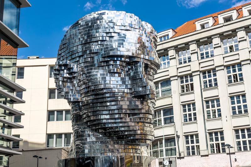 PRAGUE, CZECH REPUBLIC - APRIL, 2018: Rotating statue of Franz Kafka head in Prague, Czech Republic against blue sky. royalty free stock photography