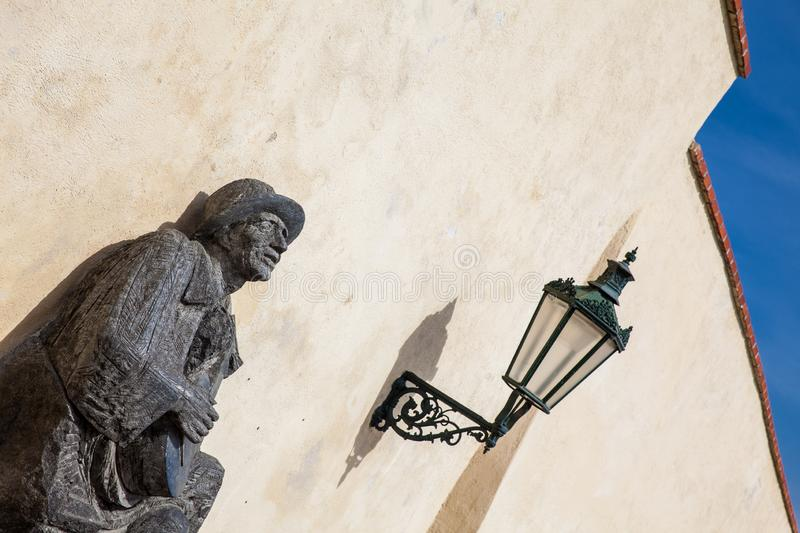 Statue of a man playing guitar at the Prague Palace royalty free stock photography
