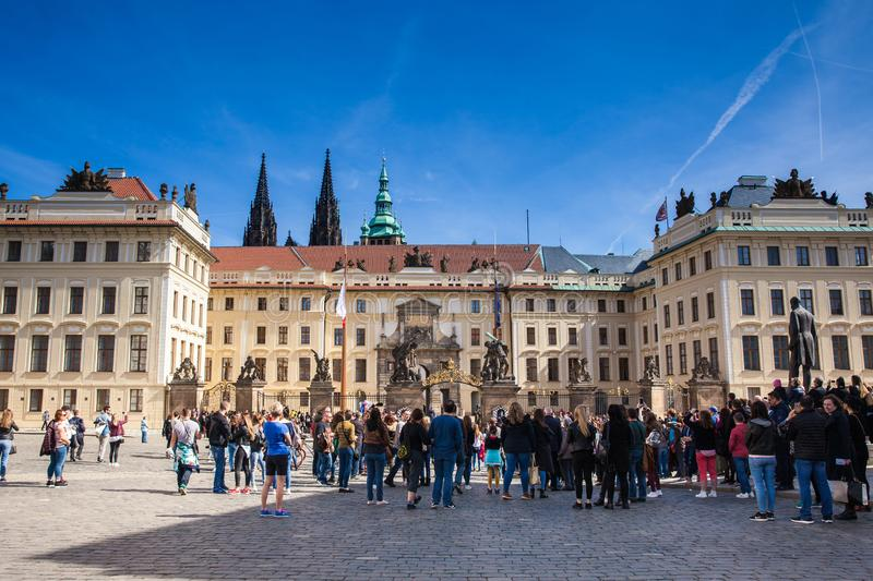 Tourists looking at midday guard change of the Prague Castle stock photos