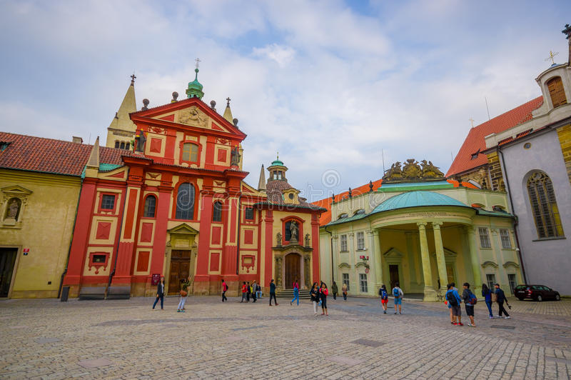 Prague, Czech Republic - 13 August, 2015: City square located around St. Vitus cathedral. beautiful building in front stock images