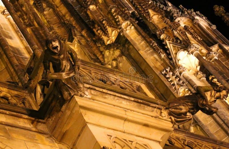 Prague, Czech Republic - August 24, 2016: Gargoyles in the Cathedral of Saints Vitus. Prague, Czech Republic - August 24, 2016: Grottesque statue of Gargoyles in stock photography