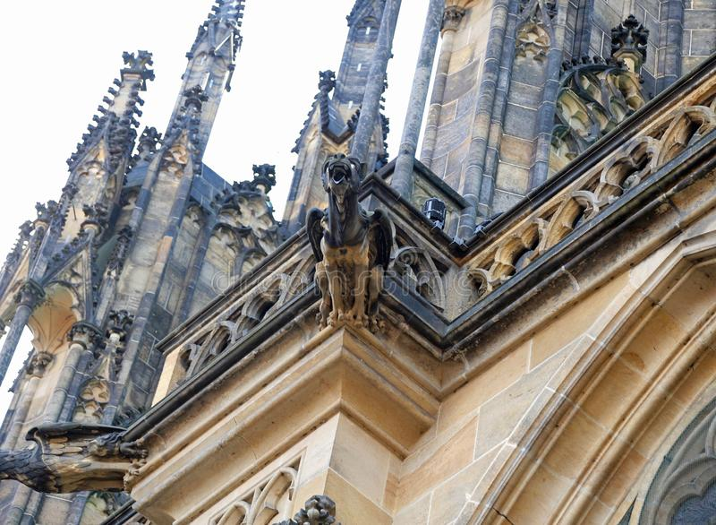Prague, Czech Republic - August 24, 2016: Gargoyles in the Cathedral of Saints Vitus. Prague, Czech Republic - August 24, 2016: Grottesque statue of Gargoyles in stock image