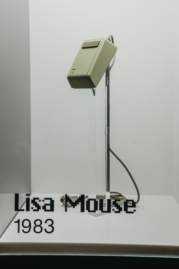 Old Apple Lisa wired mouse on exhibit inside Apple Museum in Prague, Czech Republic. Prague, Czech Republic - August 28, 2018: Old Apple Lisa wired mouse on stock image