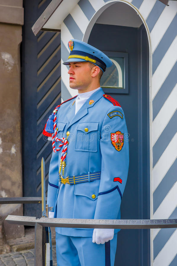 Prague, Czech Republic - 13 August, 2015: Palace guard on duty wearing his distinctive blue uniforms, white striped royalty free stock photos